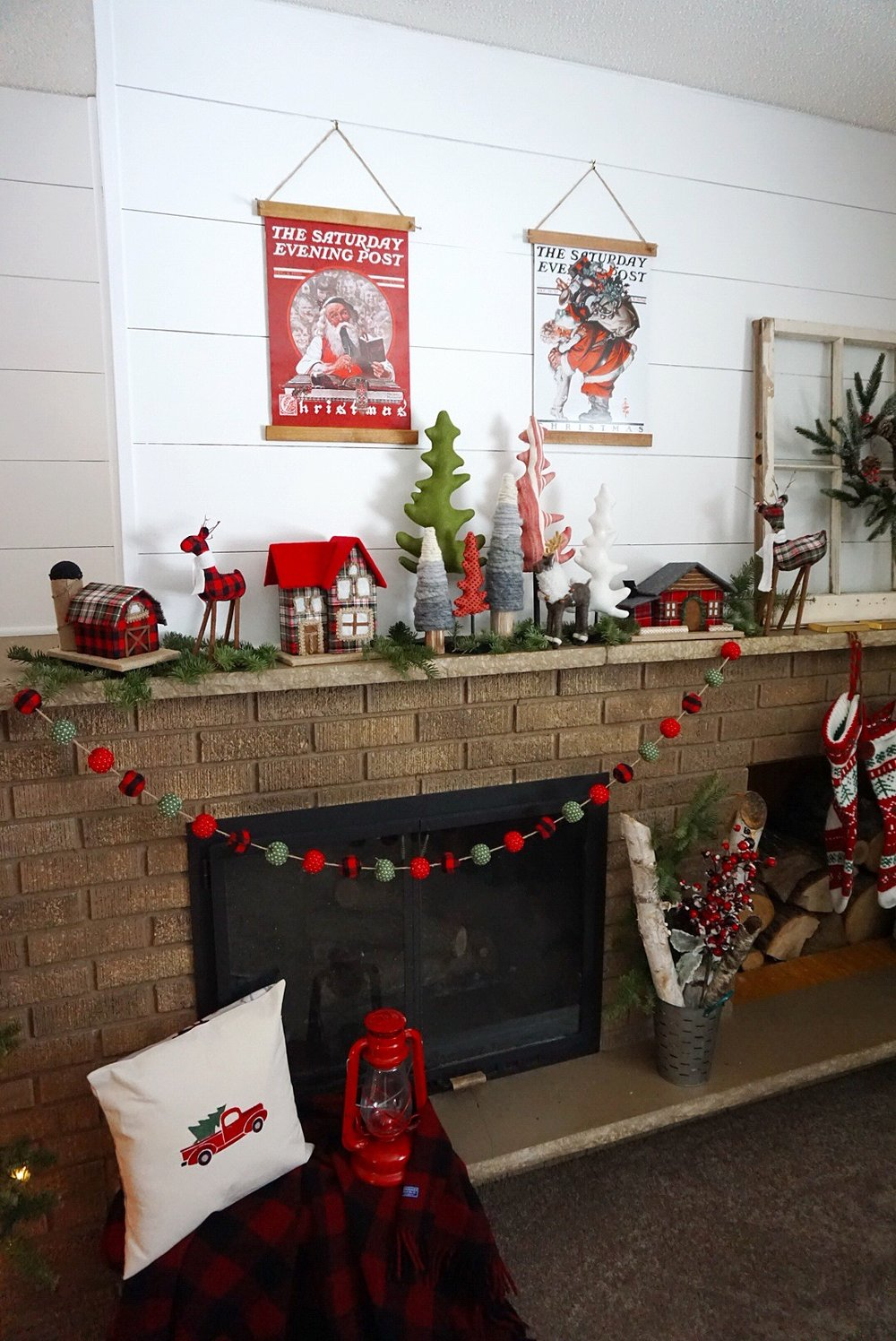 Christmas mantel with DIY vintage poster frames and classic plaid decor.