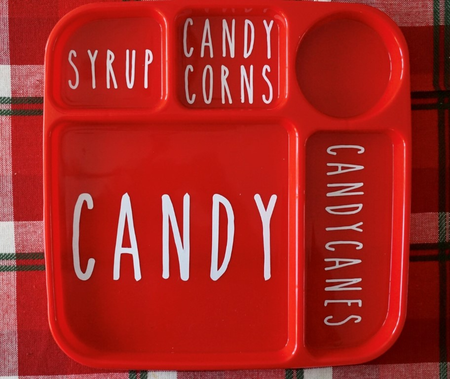 Use a Cricut or stickers to create the elf food groups on a lunch tray from Dollar Tree.