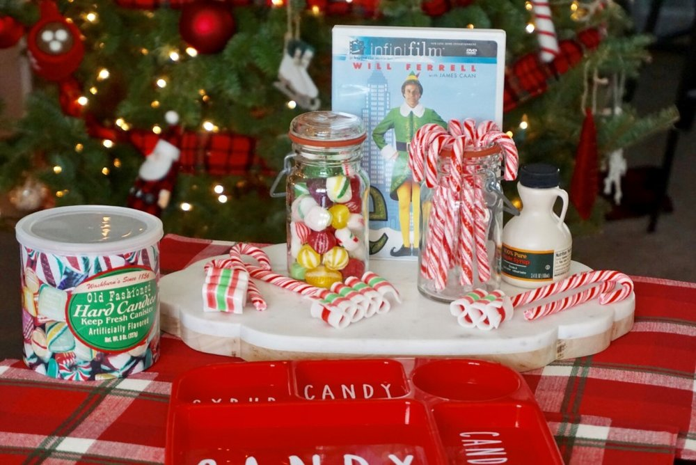 Old fashioned candy, candy canes, and syrup can make a fun snack or centerpiece for an Elf Movie Night!