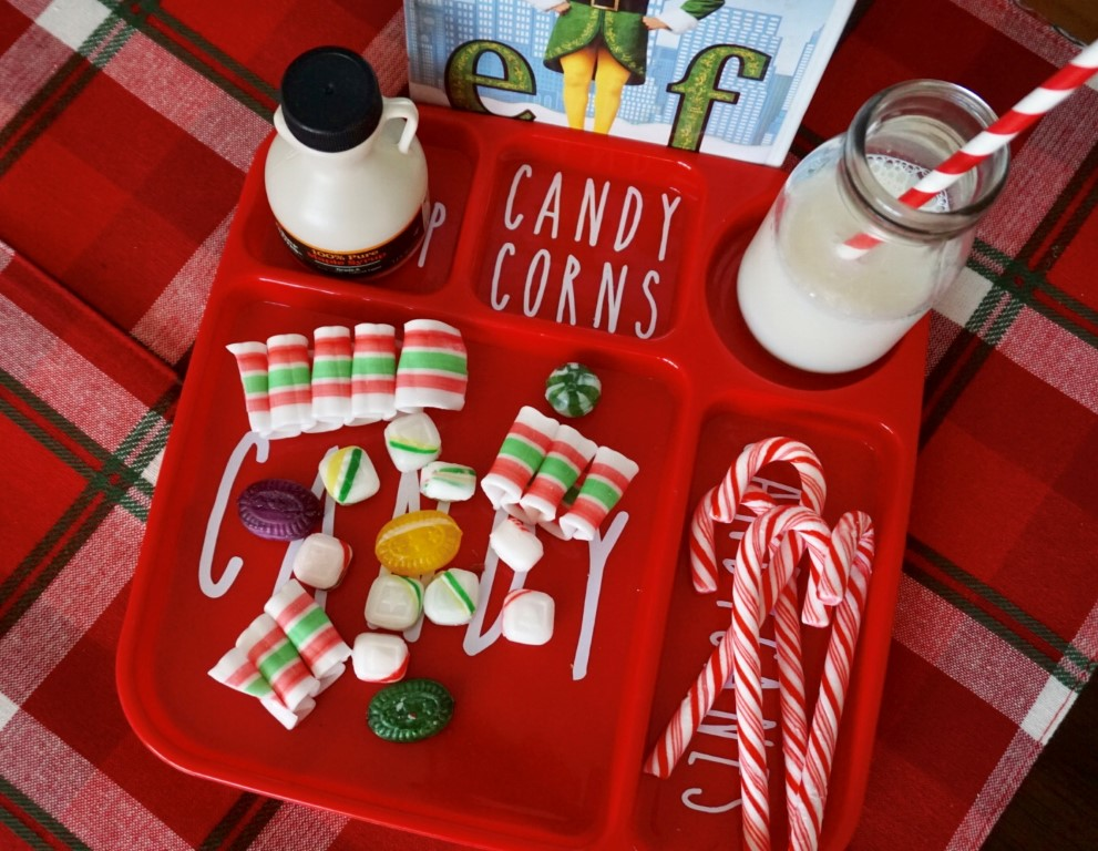 Old fashioned candy, candy canes, and syrup can make a fun snack or centerpiece for an Elf Movie Night! It looks perfect on a DIY tray!