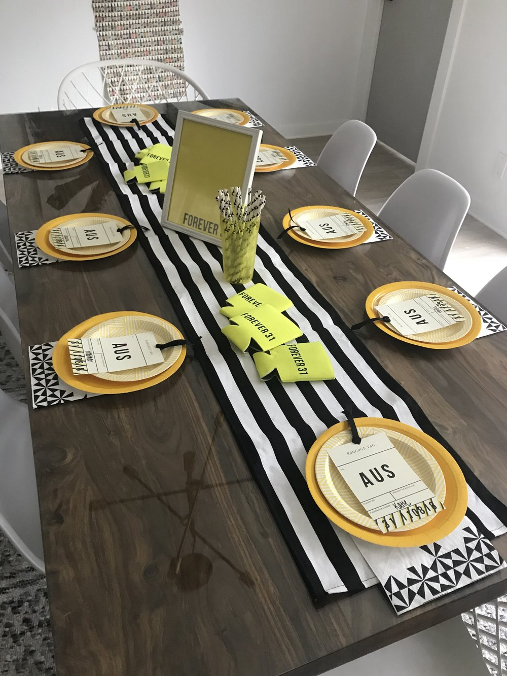 Dress up any Airbnb or vacation rental table by packing a few key items like a black and white table runner.