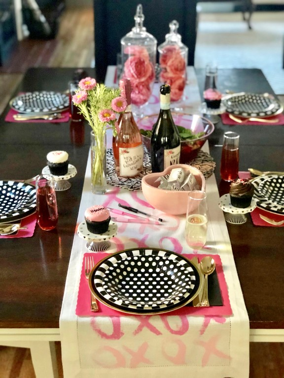 DIY Galentine's Day XOXO table runner in white and pink.