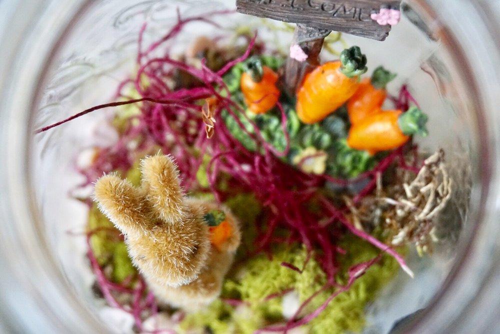 Mason jar fairy garden terrarium with an Easter bunny and carrots