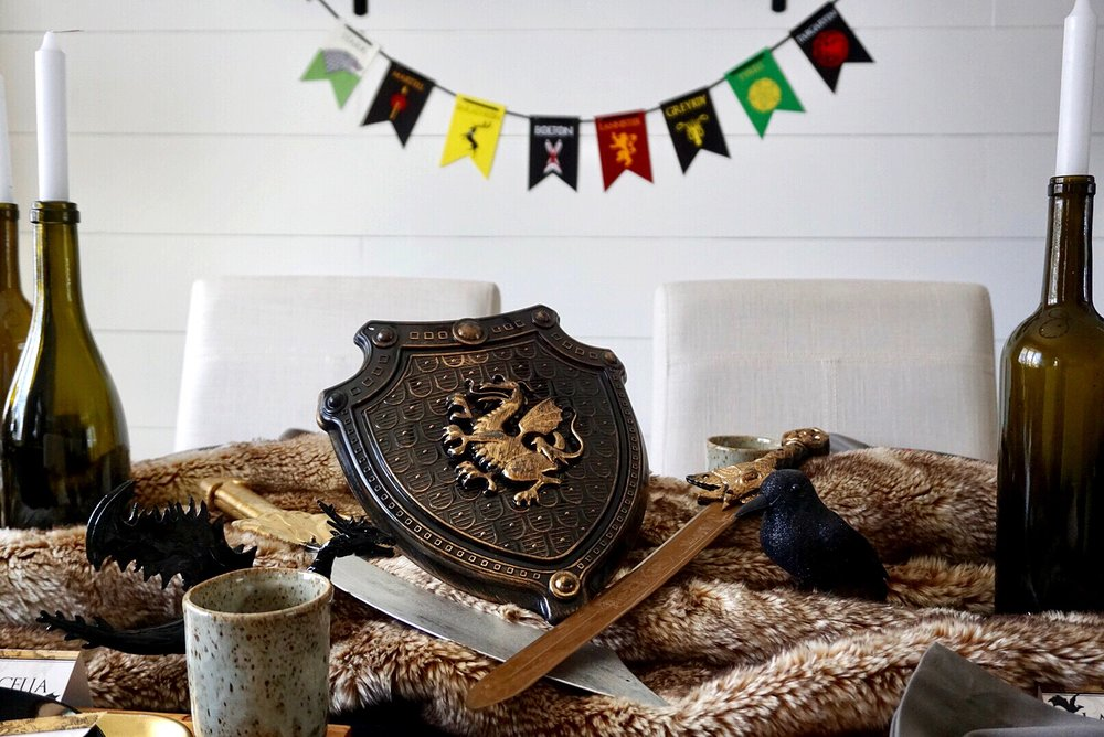 Game of Thrones dinner table with house banners