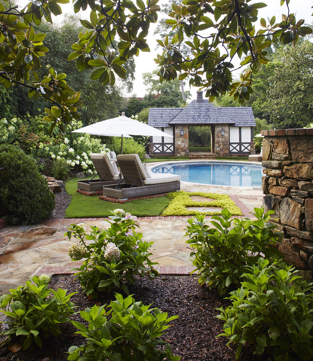 Small plants and greenery surrounds the pool.