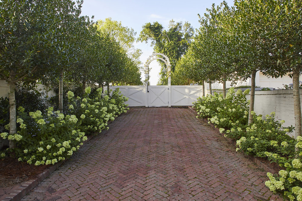Old entrance converted into a walkway and garden space.