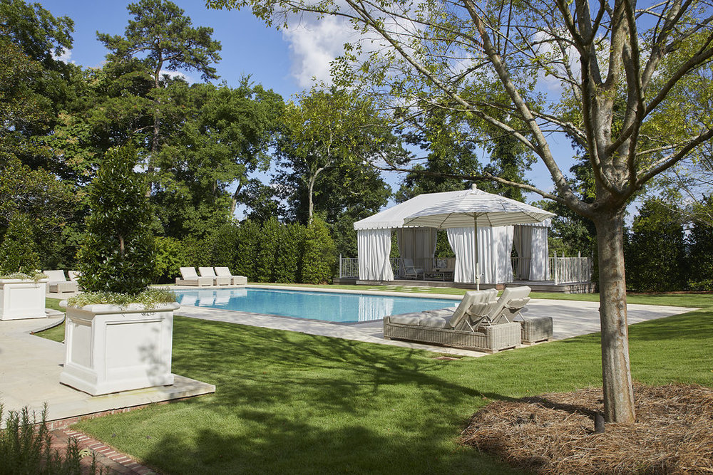 Another view of the pool with the surrounding greenery.