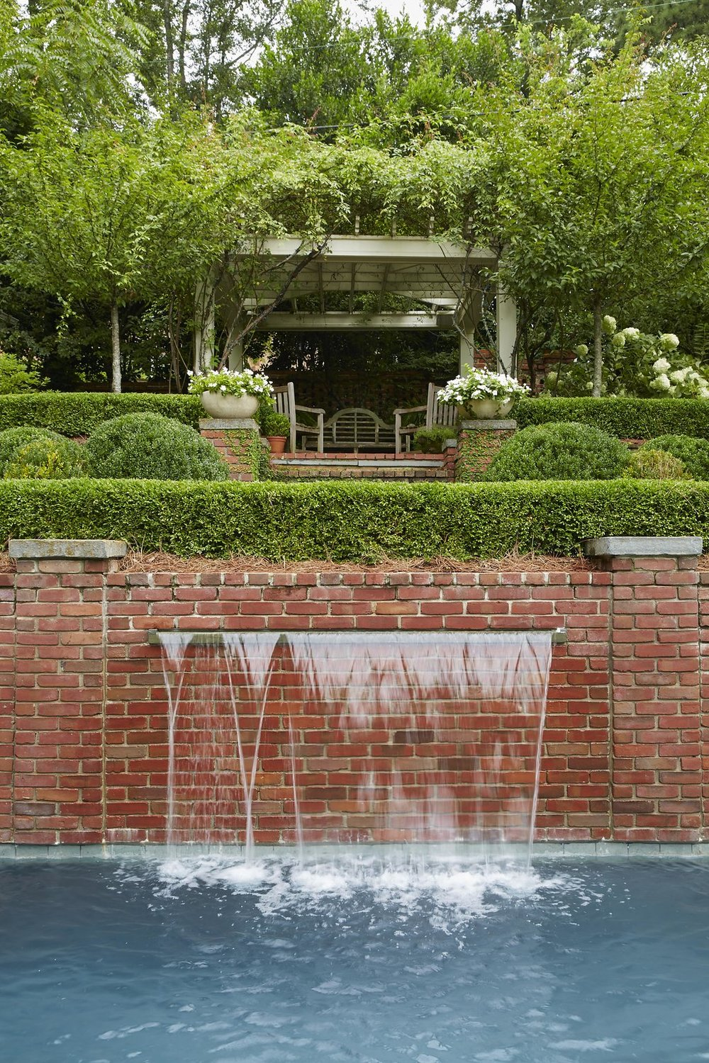 Simple custom built fountain with the terrace behind it.