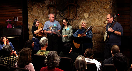 "At Puget Sound Guitar Workshop, singing ""We Are the Rainbow Sign"" with friends including Tom Rawson, Meryle Korn, Hank Payne and Ellen Van der Heuven."