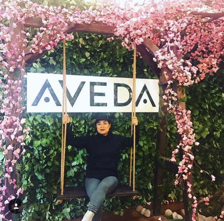 Evelyn sits on the Aveda swing.  Photo by Evelyn Neary.