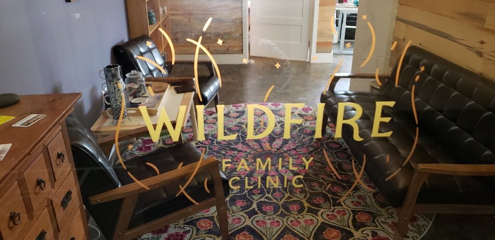 wildfire family clinic glass in office space with waiting area and 2 chairs