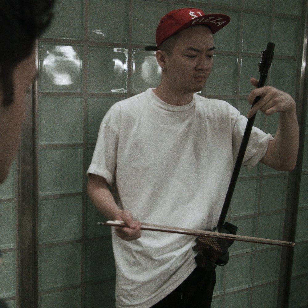 Yang Wang as ERHU PLAYER   With Gil Perez-Abraham (MARCO) ( Instragram )   Filmed at: Times Square subway station