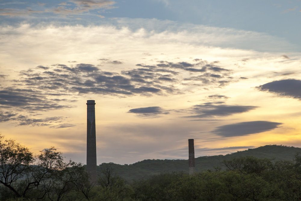 La Ramona and Julia smokestacks — two historic monuments in El Triunfo from the Ruta de Plata era