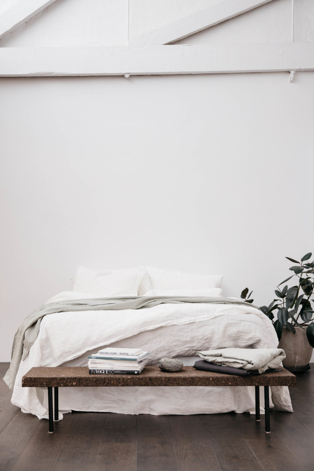 Products shown: Standard pillow cases in Optic White, Duvet Cover in Optic White, Flat Sheet in Stone.