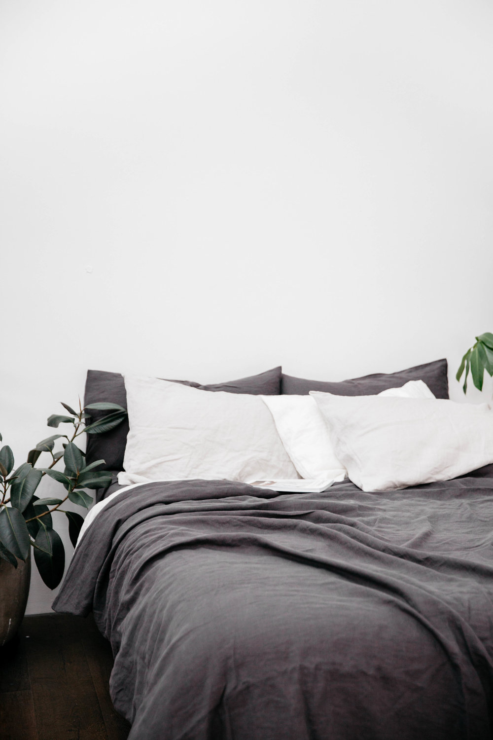 Products shown: Standard pillow cases in Optic White & Dark Grey, Duvet Cover in Dark Grey.