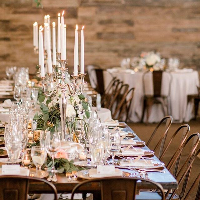 I love mixing things up! Like long wooden rectangular tables with dramatic candelabras and eucalyptus filled garlands, combined with linen draped round tables sprinkled with florals and votives... It adds texture and dimension to a large room or a flat grassy lawn, and helps create more than just one table look ✨ and in this case a touch of industrial by adding metal cafe chairs ✨ . . . Photo: @agsphotoart  Flowers: @fleursdusoleilmonterey  Rentals: @chiceventrentals  Venue + Catering: @missionranchcarmel  Planning + Design: @robin_sevrina_events . . . #weddingprofs #weddingdesign #weddingdecor #tablescape #weddingtabledecor #carmelwedding #carmelweddingplanner #californiawedding #norcalwedding #ranchwedding #robinsevrinaevents