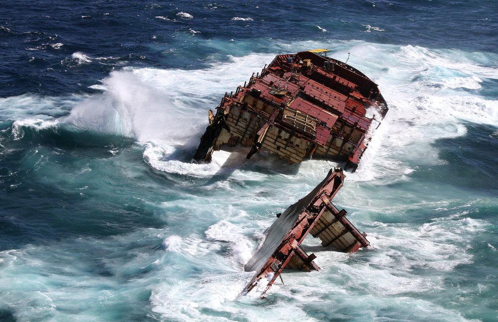 Heavy swells surround the broken Rena.   Image credit: Maritime New Zealand