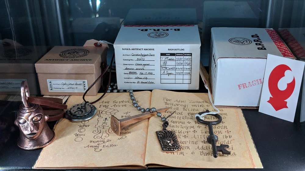 Mohlomi's Bell, Agrippa's Charm, Bog Roosh's Nail, Ogdru Jahad Amulet, St Dunstans Key, and Lobster Johnson Calling Card by Skelton Crew Studios.      Rasputin's Journal by Mike Mignola from the Hellboy Deluxe DVD