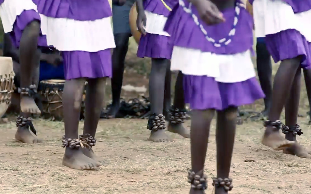 6.Acholi DANCES / Uganda / South Sudan - Acholi DANCES are traditional dances by the Acholi people from the Northern Uganda, such as Larakaraka dance or Bwola dance. Larakaraka dance is a courtship dance performed during weddings. When the youth in a particular village are ready for marriage, they organise a big ceremony where all potential partners meet. Only the best dancers will get partners, so there is a lot of competition during the dancing. Bwola dance is one of the most prestigious dances - a royal dance performed for the Acholi King. The men form a large circle and each carries a drum. The movement of the feet matches rhythmically with the beating of the drums. The women dance separately inside the circle without beating drums. The dance has a leader who moves by himself within the circle and sets the time and leads the singing.
