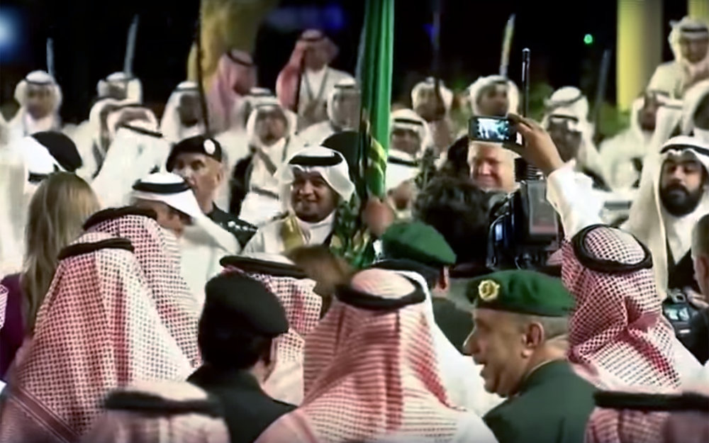 247.Donald Trump DANCE / Saudi Arabia - Donald Trump DANCE is a dance performed by the US president during his first foreign trip to Middle East. HH king Salman received Trump and he was welcomed by a traditional Saudi dance during his visit and he was invited to dance along. He joined the dance with his face depicting what dance means to him.
