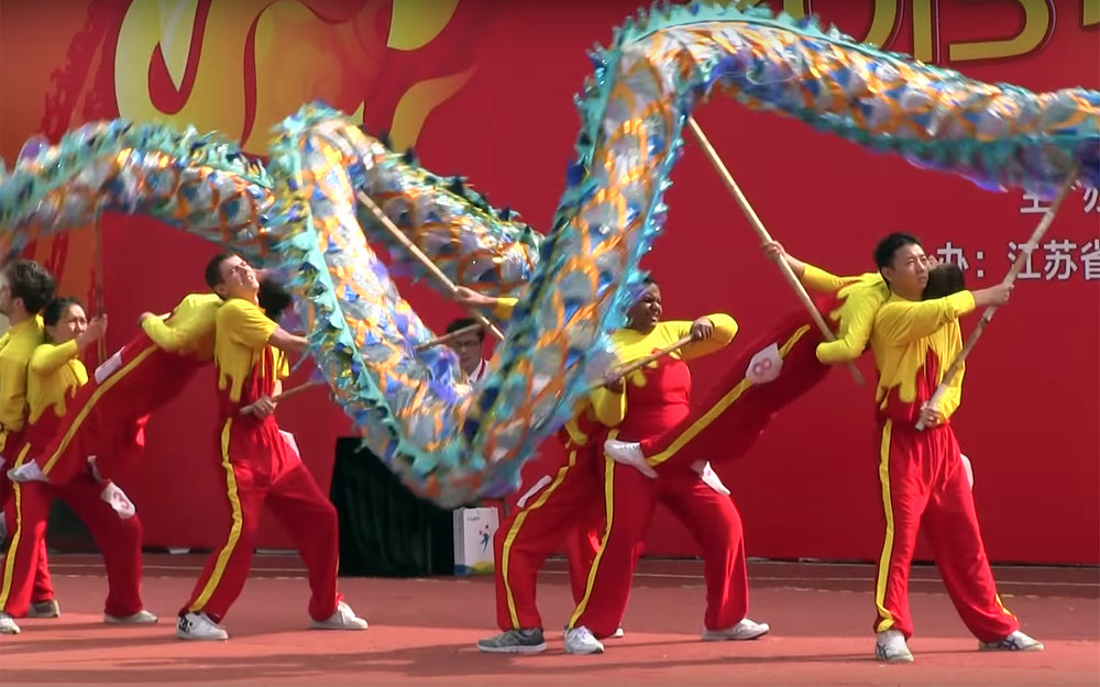 248.Dragon Dance / China - Dragon Dance is a form of traditional dance in Chinese culture. Like the lion dance it is most often seen in festive celebrations and performed by a team of experienced dancers who manipulate a long flexible figure of a dragon using poles positioned at regular intervals along the length of the dragon. The dance team simulates the imagined movements of this river spirit in a sinuous, undulating manner. It is often performed during Chinese New Year. Chinese dragons are a symbol of China's culture, and they are believed to bring good luck, therefore the longer the dragon dances, the more luck it will bring to the community. Dragon is also believed to possess qualities that include great power, dignity, fertility, wisdom and auspiciousness. The movements in a performance traditionally symbolise historical roles of dragons demonstrating power and dignity.