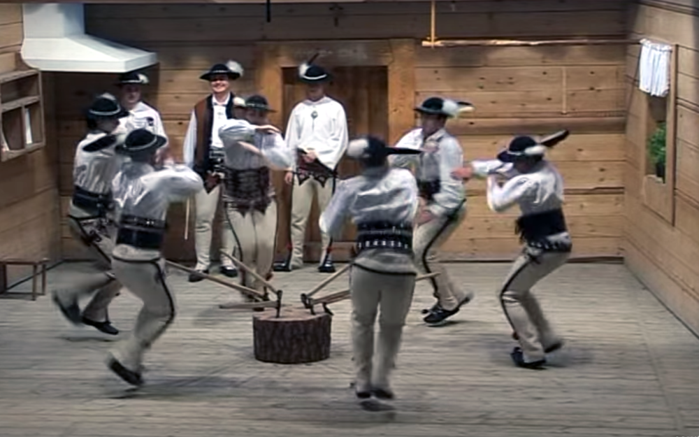 """947.ZbójnickI / Poland - ZbójnickI is a Polish folk dance from the Skalne Podhale area (the rocky foothills of the Tatra Mountains and the Tatras themselves, located in southern Poland). The name comes from an adjective created from the noun """"zbójnik"""" - a robber, in plural - """"zbójnicy"""". In the 17th-18th centuries bands of such robbers thrived in the Tatra Mountains. It is a processional dance, performed only by men. It used to be shepherds' dance with elements of war dance. It is danced by an even number of men (not less than four), one of them is a leader - """"harnaś"""". He calls the others to dance and they start walking as if to warm their muscles. The walk is energetic, following the """"bouncy"""" rhythm of the music. Walking sticks with axe heads - """"ciupagi"""" - are being used. It is a symbol of Podhale's folk culture."""