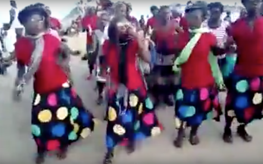 155.chilimika / Malawi - chilimika is a dance quite famous in Nkhata-Bay District in Malawi. It is known to instil the spirit of smartness. Chilimika, meaning year, is performed by the young Tonga women in the district. It is, actually, an imitation of malipenga dance which is mostly performed by men.Dancers' steps, in response to the drumbeat, seem effortless and smart such that the dance fits well with decent dressing. A handkerchief in their hands—possibly, to dust their shoes of dirt, or wipe sweat off their faces—exposes their quest for smartness. At each New Year's Day, young men and women congregate at the village arena, known as Boma, to entertain the village with chilimika.