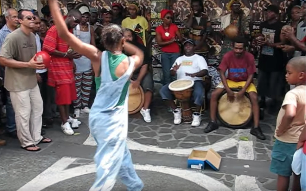 340.GWOKA / Guadeloupe / Martinique - GWOKA is a mixture of dancing, singing and playing music. Created by slaves from Africa to Guadeloupe, it was a form of political claim where the singing was based on question-answer song. Dancers and musicians together form a circle where one person is dancing in the middle. Throughout time, it is combined with local culture and nowadays Gwoka is one the most iconic culture trait of Guadeloupe. It is a dance of improvisation, a dance of the instinct, of the moment, dance of resistance, of resilience and adaptation: Dance of Life.