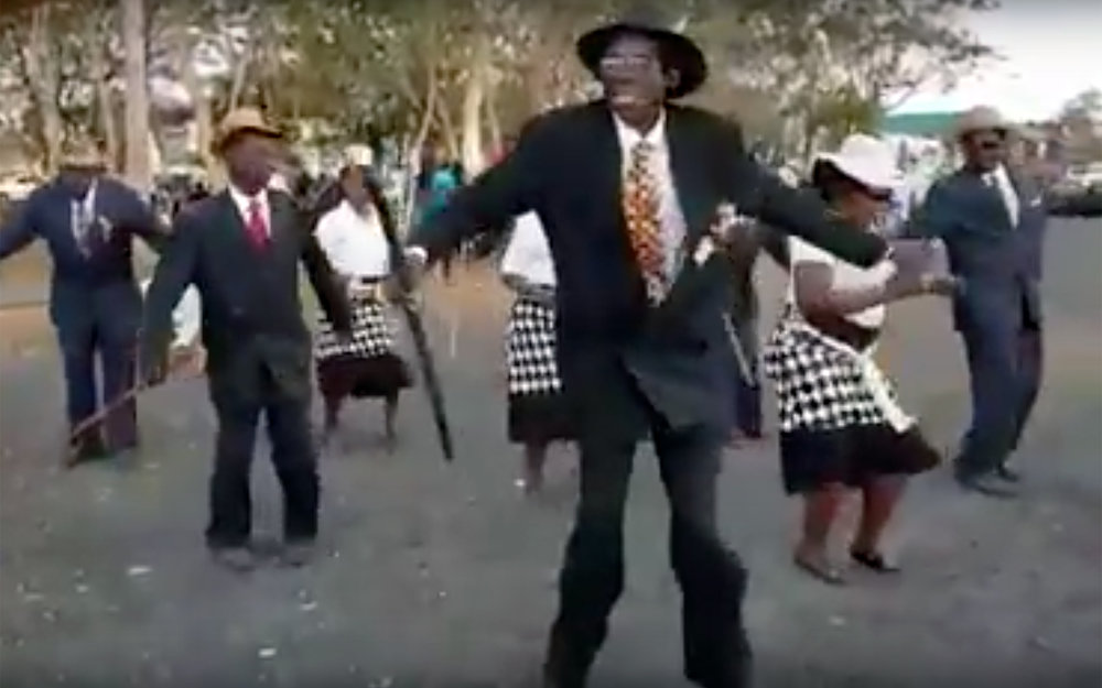 379.HONALA / Malawi - HONALA is a name of a popular dance from the Nkhata Bay people in Malawi. The dance is secular in nature and it is performed by both men and women, dressed in elegant clothing. It is danced to melodic tuned of live accordion music.