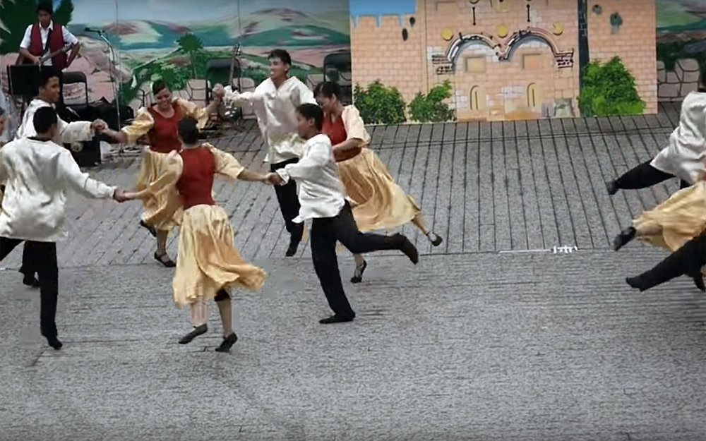 """381.HORAH / Israel - HORAH is a circle Jewish dance that predates the State of Israel and it became an icon of Jewish and Israeli folk dance. It can be performed to many of the traditional klezmer and Israeli folk songs, traditionally to the music of """"Hava Nagila"""". In its pioneer version, horah was done at a whirling, breakneck pace. Each dancer's arms were around the shoulders of those flanking him, with the circle spinning so fast that dancers were sometimes lifted off the ground. Dancing often continued for hours. In the early days, horah was popular mainly in kibbutzim and small communities. Nowadays it is the most common dance at the Jewish life celebration such as weddings and Bar, and Bat Mitzvahs. It also became popular at celebrations by Jews in the United States, United Kingdom and Canada."""
