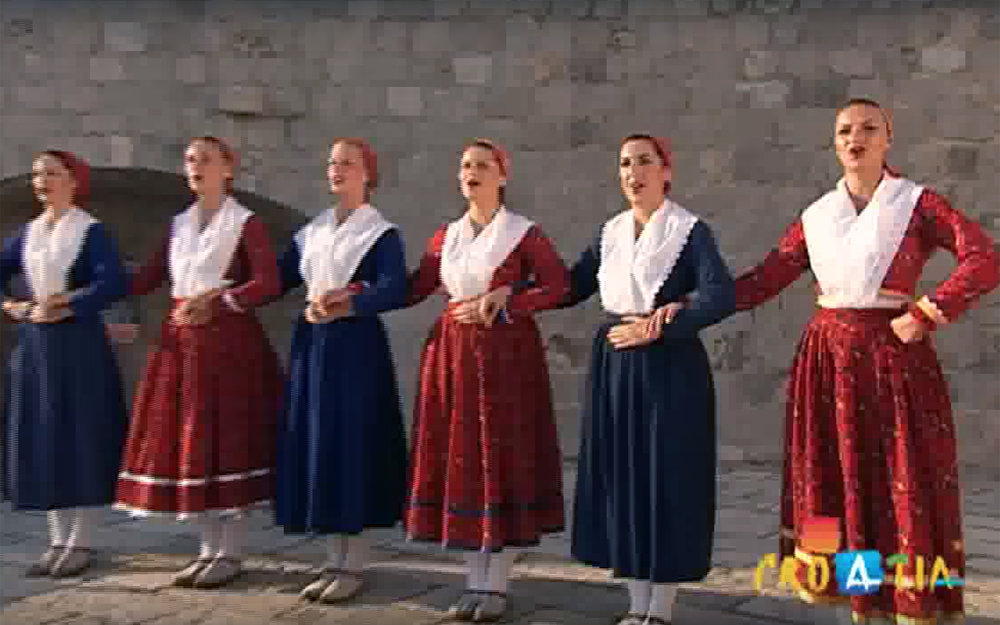 516.Lindjo / Croatia - Lindjo is the most popular dance of the Dubrovnik coastal region in Croatia. It is danced to the accompaniment of lijerica (an old South Dalmatian instrument with three strings). It is extensively performed in the Dubrovnik's region, in Konavle area, in Dubrovačko Primorje on the Pelješac Peninsula and on the islands of Mljet and Lastovo, as well as parts of Herzegovina. The dance master plays sitting, with lijerica on his left knee, while stamping with his right foot, thus dictating rhythm to the dancers. They move in a circle around the dance master, who gives commands (in rhyme, humorous and often with double meaning). He also decides who will dance with whom and dictates the change of dance figures, along with encouraging the dancers to compete in improvisations.