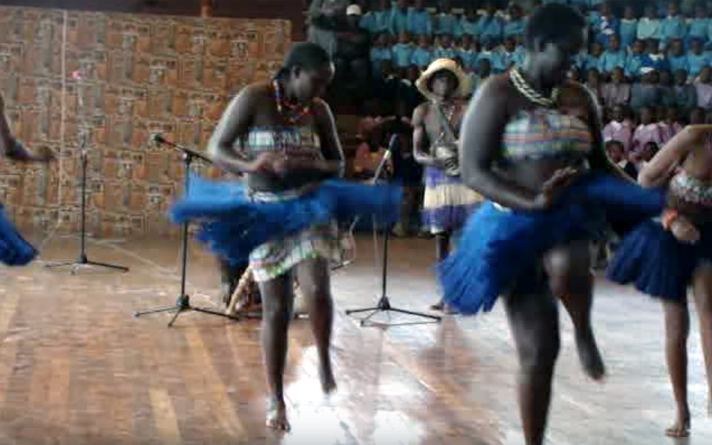 553.LUO DANCES / Kenya - LUO DANCES are elegant and graceful dances performed by the Lou people from Kenya, accompanied by folk music.They involved either the movement of one leg in the opposite direction with the waist in step with the syncopated beats of the music or the shaking of the shoulders vigorously, usually to the tune of the nyatiti, an eight-stringed instrument.
