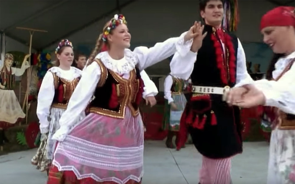 """565.Mazur / Poland - Mazur is a traditional Polish folk dance from Masovia. It combines similarity with mazurek and oberek (at a faster rate) and kujawiak (slow). It is characterized by a tendency to accentuate the second and third parts of the bar and a rhythmic figure with a 4-syllable group. It is a cheerful, dynamic dance, which was often danced at noble mansions. It is danced in the 3/8 metre and performed in a lively tempo. It features three steps in the course of a dynamic, fast walking with a flat leap between the third and first beat of the bar, as well as gliding steps forward, backward, sideways, or with a turn. These steps are frequently supplemented with ornamental elements and dynamic accents (""""hołubiec"""" [clicking of heels], strikes, take-offs, and stomps)."""