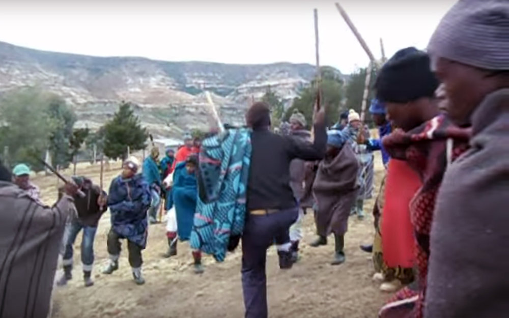 588.Mokorotlo / Lesotho - Mokorotlo refers to the traditional male dance performed by male initiates and elders of the Sotho tribes in Lesotho. Performed by men for the chief on important occasions, it is also taught as a song to youths at initiation school, serving to give them courage and motivation to persevere during their isolation in the mountains. Male initiates are expected know their ancestral praises, which are recited at coming-out initiation ceremonies. Mokorotlo is derived from the word ho korotla, meaning 'to grumble in a low voice', most appropriate during battle. In the past, Basotho men sang mokorotlo when they prepared to go to war.