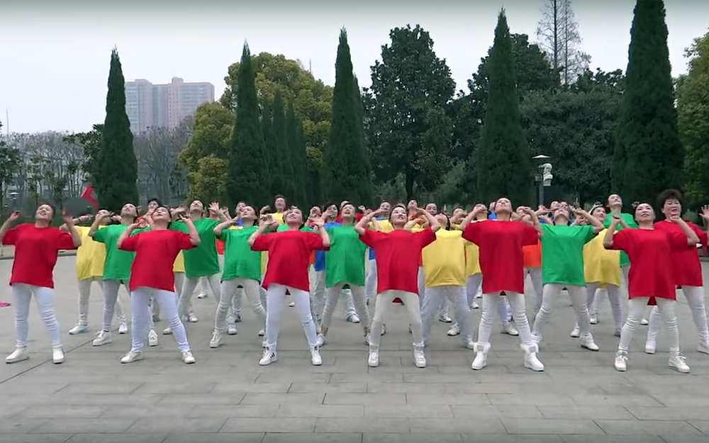 804.Square dancing / China - Square dancing is an exercise routine, performed to music in squares, plazas or in parks in the People's Republic of China. It is popular with middle-aged and retired women who were called