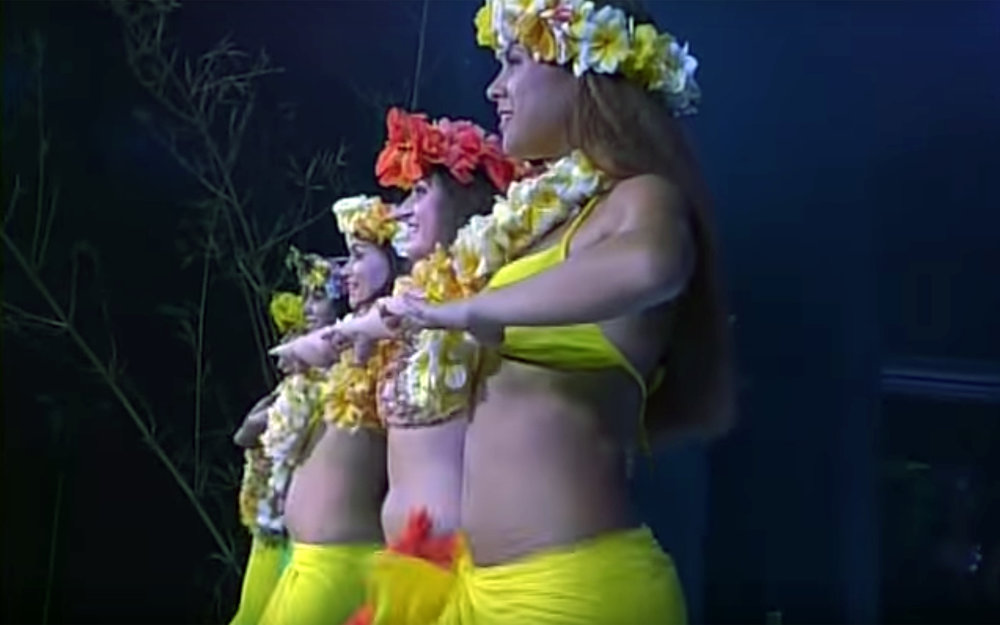 """830.TAMURE / Tahiti - TAMURE is the oldest dance from Tahiti. When Europeans colonists arrived in Tahiti in mid 19th century, they prohibited this dance because of its erotic, almost satanic aspect. Half a century later, French protectorate allowed to perform it again. Its movements are based on warrior dance and daily life gestures. Usually danced as a group of boys and girls, all dressed in more (the Tahitian grass skirt, not made of grass but of the fibres from the bark of the """"pūrau"""" (hibiscus). Boys shake their knees and the girls shake their hips. The girls are largely standing still, the boys move around their partner, either facing her in front or hiding behind her back. The tempo of the music is continuously increasing to the point where only the most experienced and fittest dancers can keep their shakings up."""