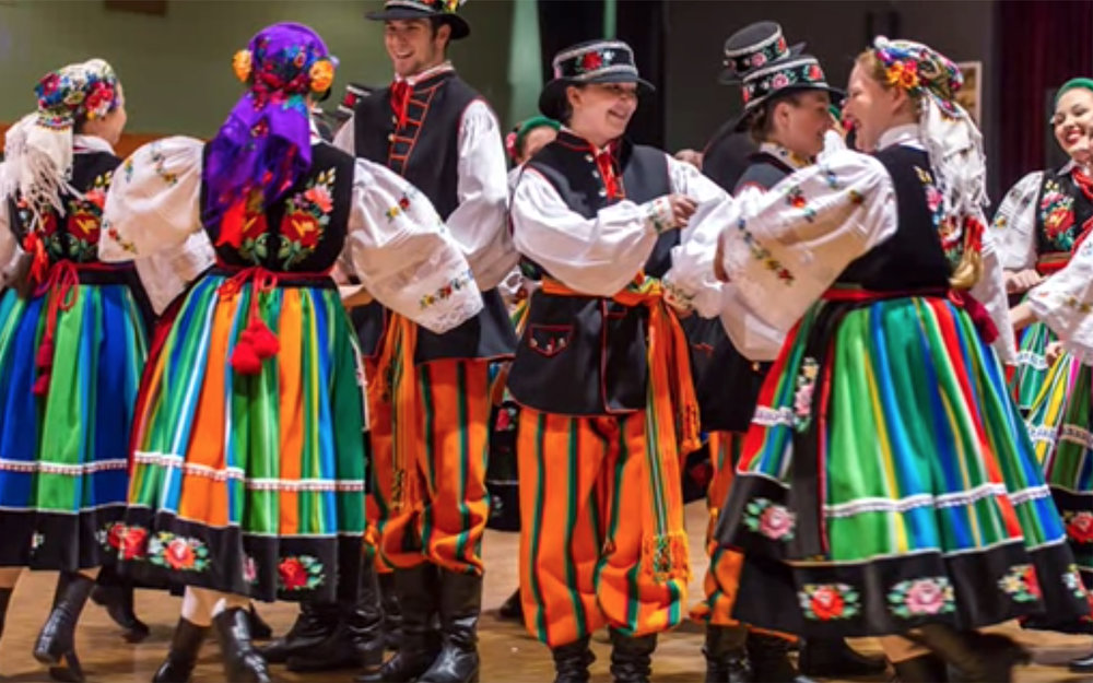 """703.Powolniak / Poland - Powolniak is the best known traditional dance from the Kurpie Zielone, an area in the north of the Mazovia region in Poland. It consists of two parts and it is performed by pairs in a fast tempo, with quick spinning demanding a lot of energy and control (despite the literary meaning of its name """"powolniak"""" from the word """"powolnie"""" - slowly, deliberately). The dance is characterised by polyrhythm, i.e., the performance of steps in the odd metre to the music in duple metre."""