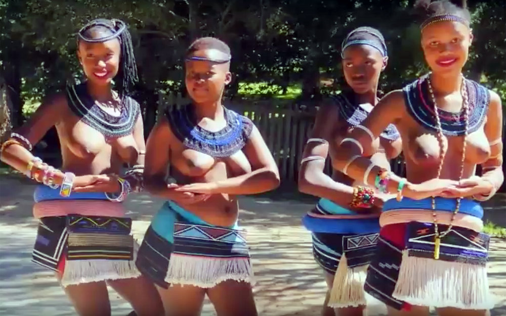 929.Umhlanga reed dance / Swaziland - Umhlanga reed dance is an annual eight-day event in Swaziland. Tens of thousands of unmarried and childless Swazi girls and women travel from the various chiefdoms to the Ludzidzini Royal Village. They are required to undergo a virginity test before they are allowed to participate. They dress in short beaded skirts, colourful sashes, ankles and bracelets, and they dance bare-breasted for the king. Each maiden carries a long reed which is then deposited as they approach the kind. If the reed should break before that, it is considered a sign that a girl has already been sexually active. Reed dance was created in the 1940s and reintroduced in 1991 to encourage young Zulu girls to delay sexual activity until marriage and thus limit the possibility of HIV transmission. In 2007 about 30,000 girls took part in the event.