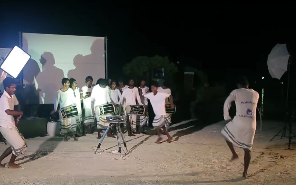 Bodu Beru / Maldives - Bodu Beru is a dance coming from the Maldives. It is similar to some of the songs and dances found in East Africa. Most likely the music was introduced to the Maldives by sailors from the Indian Ocean region. Boduberu is performed by about 20 people, including three drummers and a lead singer. They are accompanied by a small bell, a set of drums also known as a bodu beru, and an onugandu - a small piece of bamboo with horizontal grooves, from which raspy sounds are produced by scraping. The songs may be of heroism, romance or satire. The prelude to the song is a slow beat with emphasis on drumming, and dancing. As the song reaches a crescendo, one or two dancers maintain the wild beat with their frantic movements ending in some cases in a trance.