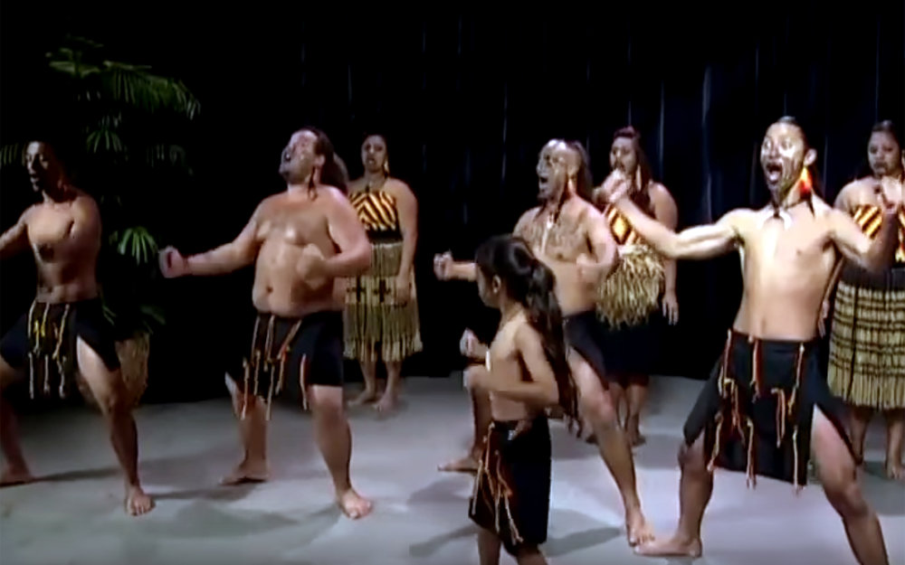 Māori dance / Cooks Island - Māori dance is a set of traditional dances by Maori people from the Cooks Island. Dance is an important part of the local culture, often performed at multicultural festivals. One of the popular traditional Maori dances is called Ura - a sacred ritual usually performed by a female who moves her body to tell a story, accompanied by intense drumming by at least five drummers. Moving the hips, legs and hands give off different gestures to the audience to tell a tale, typically related to the natural landscape such as the ocean and birds and flowers, but also feelings of love and sadness. Women typically wear a grass skirt, with flowers and shell headbands and necklaces. Men vigorously flap their knees in a semi-crouched position while holding their upper bodies steady, and typically wear grass skirts and headbands.