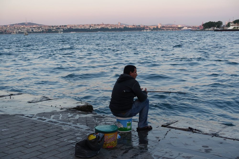 Istanbul | man on a dock fishing in the Bosphurus | Bosphurus | ©sandrine cohen