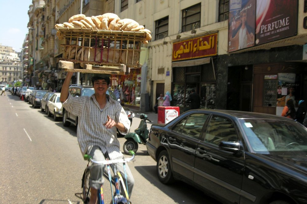 Cairo   young man on his bike carries breads   Egypt   ©sandrine cohen