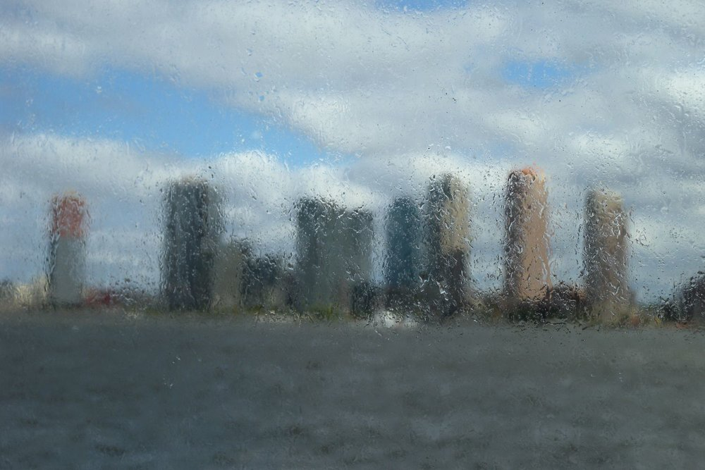 Brooklyn towers through boat window | photo sandrine cohen