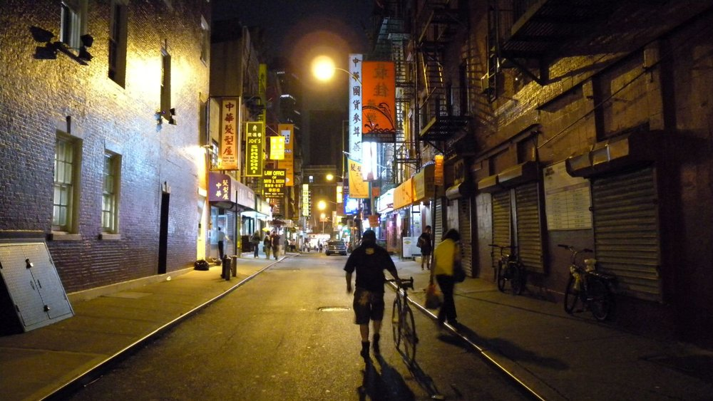 New York | Chinatown at night | Moore street | Man with bicycle at Chinatown | photo sandrine cohen