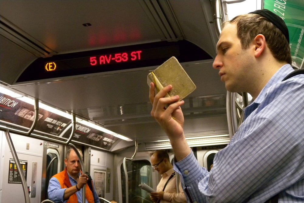 New York subway | Jew reading Bible on subway | photo sandrine cohen