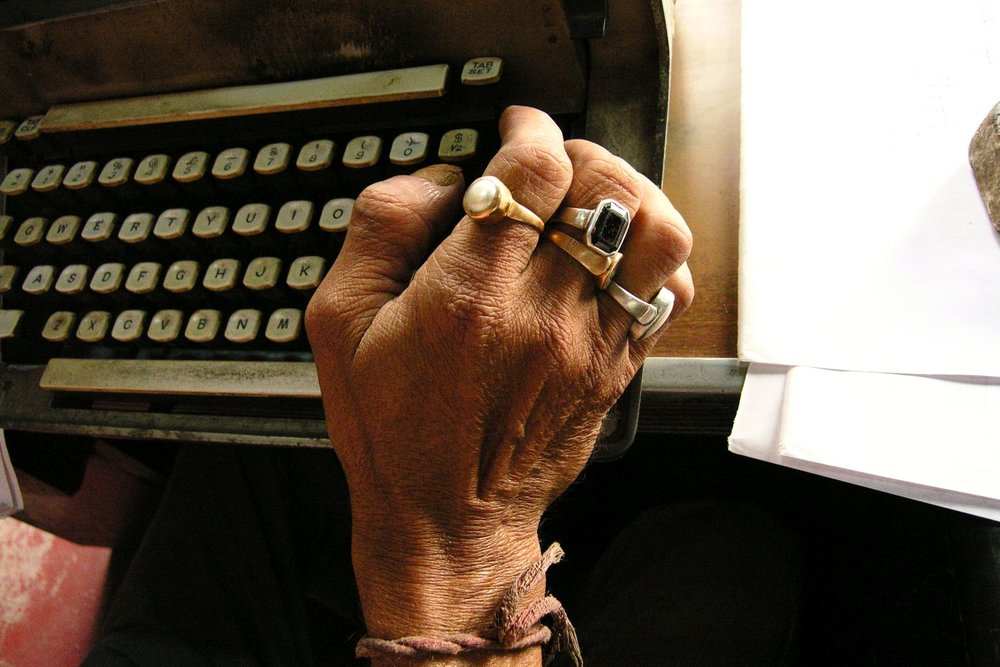 Kolkata - Calcutta | Indian office worker and typewriter office worker with rings and typewrite | ©sandrine cohen