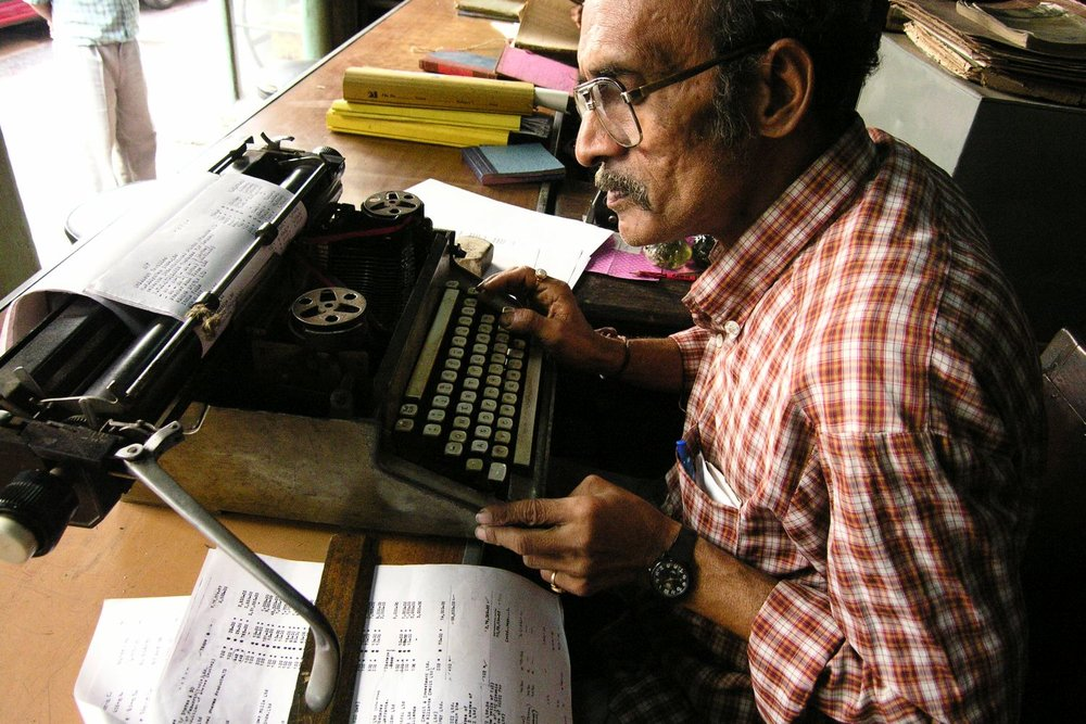 Kolkata - Calcutta | Indian office worker and typewriter office worker typing at the typewrite | ©sandrine cohen
