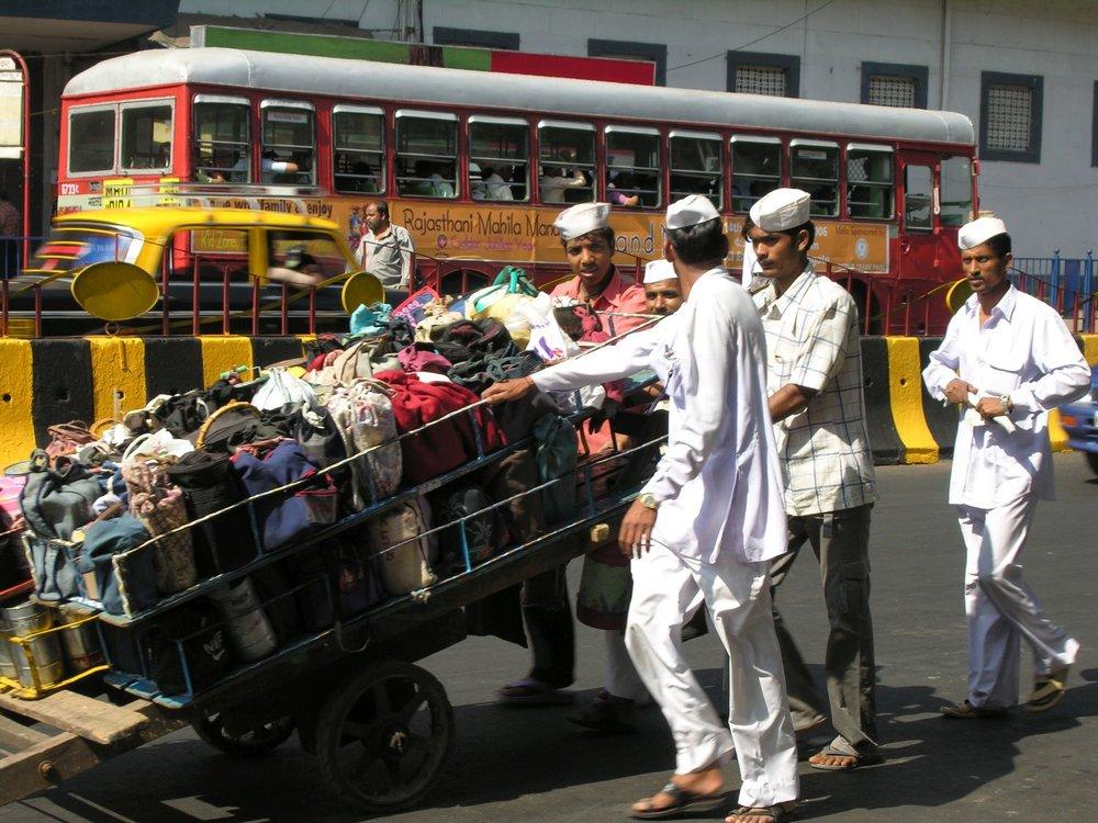 Mumbai - Bombay | Mumbai dabbawala | Dabbawalas | Churchgate station | Men carrying lunch boxes | ©sandrine cohen
