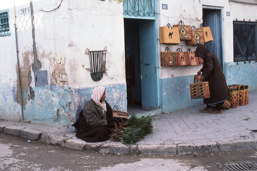 Tunisia | Nabeul | Shop and man sitting in the street | photo sandrine cohen