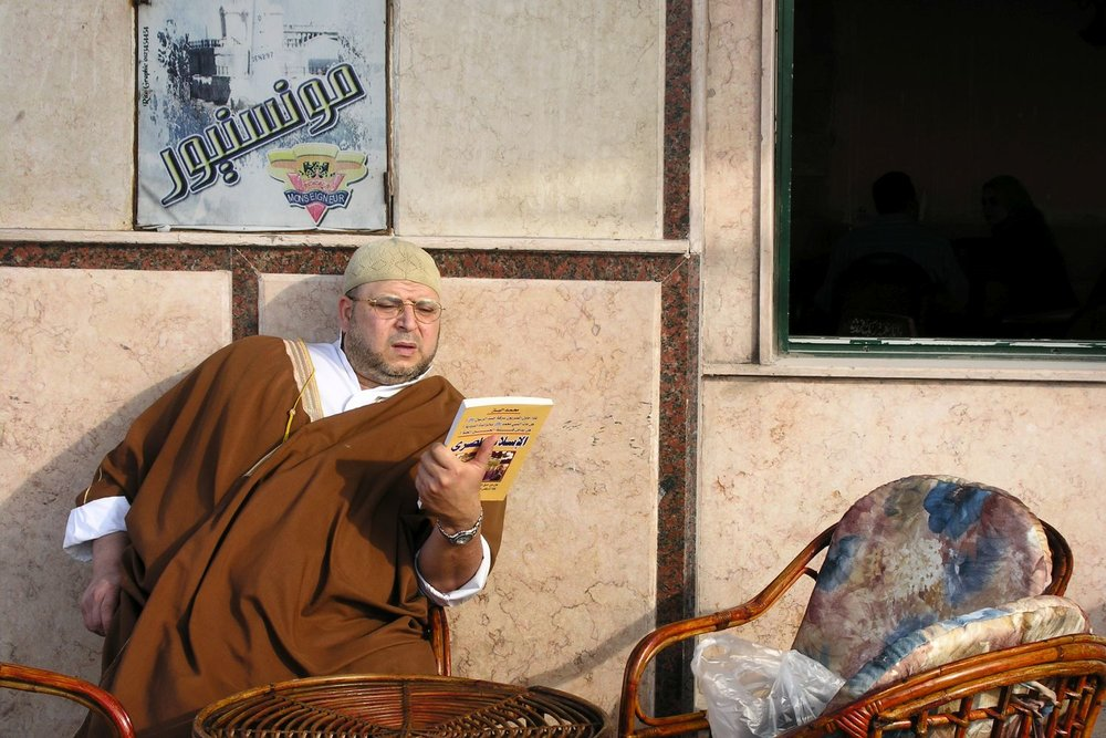 Alexandria | Egypt | Alexandria Cafe | Man reads a book on the terrace of the cafe | Muslim read a book | ©sandrine cohen